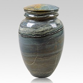 A marble cremation urn honors a lost individual with nature