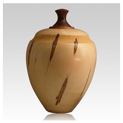 Wooden cremation urns offer one of the most extensive lines of designs available